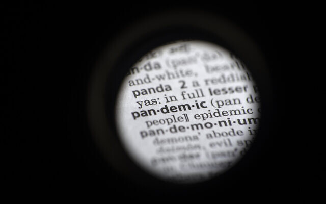 The word 'pandemic' in seen in a dictionary. (AP Photo/Jenny Kane)