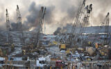 Aftermath of a massive explosion is seen in in Beirut, Lebanon, Tuesday, Aug. 4, 2020. A Lebanese prosecutor filed charges Tuesday, Nov. 24, 2020 against current and former customs officials over the massive blast at Beirut's port in August, including a former customs chief who was reportedly the point man for the militant Hezbollah group at the facility. (AP Photo/Hassan Ammar, file)