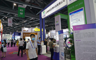 Shanghai-based testing kit company GeneoDx presents a booth at a trade fair in Nanchang in eastern China's Jiangxi province on Saturday, Aug. 22, 2020. (AP Photo/Dake Kang)