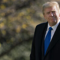US President Donald Trump walks on the South Lawn of the White House in Washington, November 29, 2020, after stepping off Marine One. (AP Photo/Patrick Semansky)