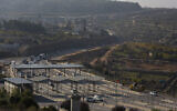 A view of a road in the West Bank, south of Jerusalem, November 29, 2020. (AP Photo/Majdi Mohammed)