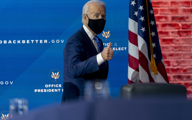 US President-elect Joe Biden departs a news conference after introducing his nominees and appointees to economic policy posts at The Queen theater, Tuesday, Dec. 1, 2020, in Wilmington, Del. (AP Photo/Andrew Harnik)