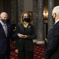 Sen. Mark Kelly, Democrat-Arizona, with his wife former Rep. Gabby Giffords, Democrat-Arizona, participates in a re-enactment of his swearing-in ceremony in the Old Senate Chamber on Capitol Hill in Washington, December 2, 2020. (Nicholas Kamm/Pool via AP)