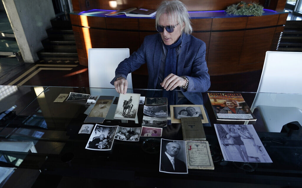 Jed Leiber shows photos of his grandfather Saemy Rosenberg's life, Dec. 3, 2020, at Leiber's home in Los Angeles. (AP Photo/Marcio Jose Sanchez)