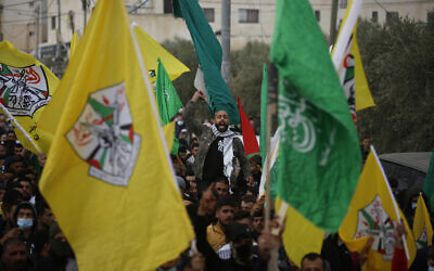 Palestinians attend the funeral of a 13-year-old Ali Abu Aliya who was reportedly shot dead by Israeli military forces during clashes with stone-throwing Palestinians, in the al-Mughayyir village near the West Bank city of Ramallah, Saturday, Dec. 5, 2020. (AP Photo/Majdi Mohammed)