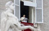 Pope Francis delivers his blessing as he recites the Angelus noon prayer from the window of his studio overlooking St. Peter's Square, at the Vatican, December 6, 2020. (AP Photo/Andrew Medichini)