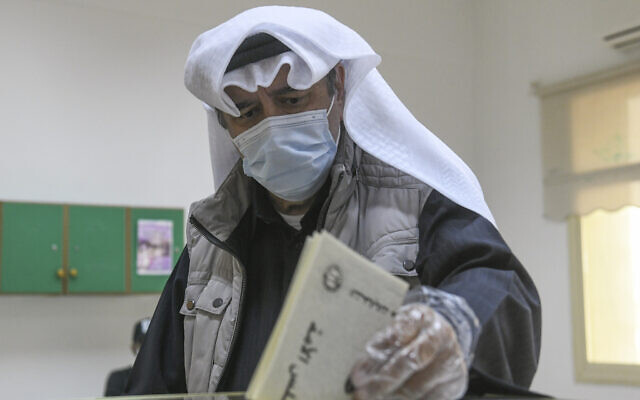 A man casts his vote for parliamentary elections in the town of Hawally, Kuwait, December 5, 2020. (Jaber Abdulkhaleg/AP)