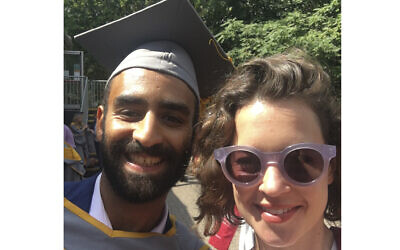 Karim Ennarah (L) and his now-wife Jess Kelly, after graduating from the School of Oriental and African Studies, London, in 2018. (courtesy of Jess Kelly via AP, File)