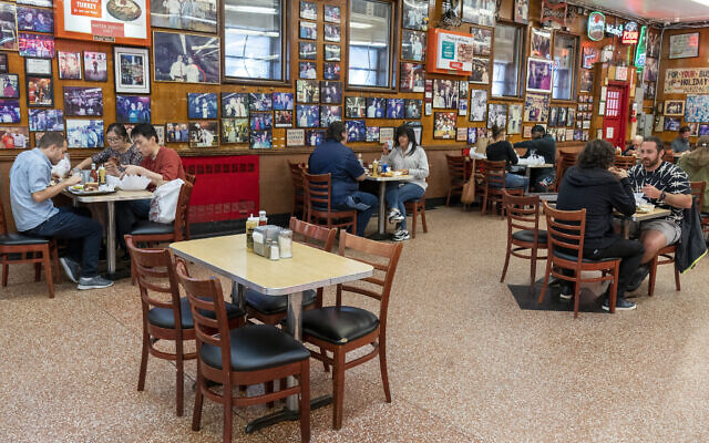 In this September 30, 2020, file photo, tables are spaced allowing for proper social distancing as customers enjoy lunch indoors at Katz's Delicatessen in New York. (AP/Mary Altaffer, File)