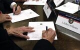 Members of the Mississippi Electoral College sign certificates of votes in the process of formally casting their electoral votes in the 2016 US presidential elections, at the Capitol in Jackson, Mississippi, December 19, 2016. (AP Photo/Rogelio V. Solis, File)