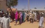 People gather inside the Government Science Secondary School in Kankara, Nigeria, Dec,ember 12, 2020. (AP Photo/Abdullatif Yusuf)