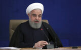 Iranian President Hassan Rouhani speaks during a press conference in Tehran, Iran, December 14, 2020. (Iranian Presidency Office via AP)
