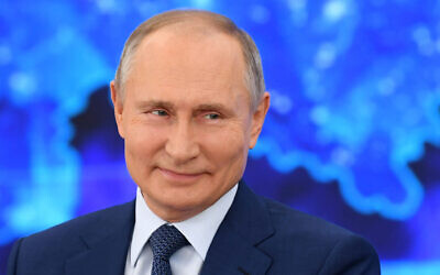 Russian President Vladimir Putin speaks via video call during a news conference in Moscow, Russia, December 17, 2020. (Aleksey Nikolskyi, Sputnik, Kremlin Pool Photo via AP)