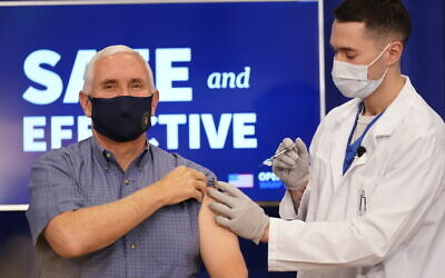 US Vice President Mike Pence receives a Pfizer-BioNTech COVID-19 vaccine shot at the Eisenhower Executive Office Building on the White House complex on December 18, 2020, in Washington.   (AP/Andrew Harnik)