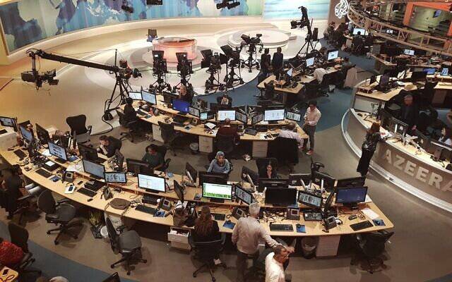 Al-Jazeera staff work at their TV station in Doha, Qatar, June 8, 2017. (AP Photo/ Malak Harb, File)