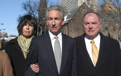 In this March 4, 2005 file photo, Charles B. Kushner, flanked by his wife, Seryl Beth, left, and his attorney Alfred DeCotiis arrives at the Newark Federal Court for sentencing in Newark, New Jersey (AP /Marko Georgiev)
