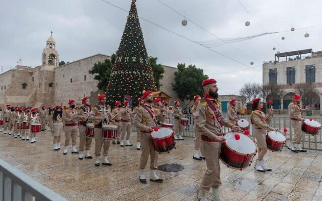 Palestinian scout bands parade through Manger Square at the Church of the Nativity in the West Bank city of Bethlehem, Thursday, Dec. 24, 2020 (AP Photo/Nasser Nasser)