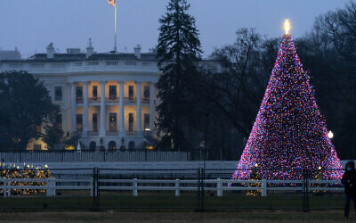 The National Christmas Tree glows with lights on the Ellipse near the White House, Thursday, Dec. 24, 2020, on Christmas Eve in Washington. (AP/Jacquelyn Martin)