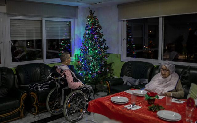 Two elderly people wait for Christmas eve dinner at an elderly care home in Pozuelo de Alarcon, outskirts of Madrid on Dec. 24, 2020. Many of the elderly in the residence haven't celebrated Christmas eve with their relatives to prevent the spread of coronavirus (AP/Bernat Armangue)