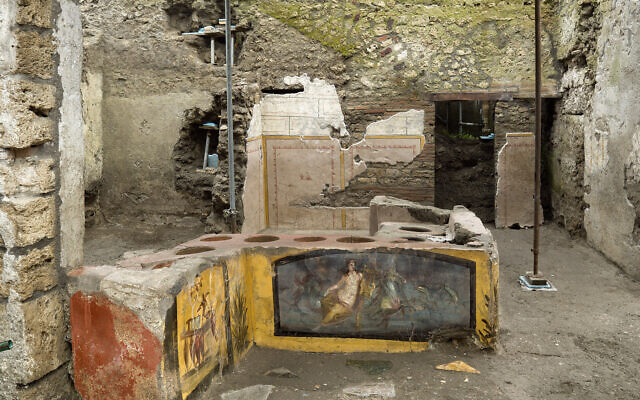 An undated photo made available by the Pompeii Archeological park press office shows the thermopolium in the Pompeii archeological park, near Naples, Italy.(Luigi Spina/Parco Archeologico di Pompei via AP)
