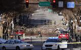 Investigators continue to examine the site of an explosion, December 27, 2020, in downtown Nashville, Tennessee. (AP Photo/Mark Humphrey)