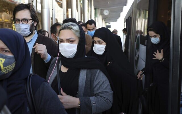 People wear protective face masks to help prevent the spread of the coronavirus in downtown Tehran, Iran. October 11, 2020. (AP Photo/Ebrahim Noroozi, File)