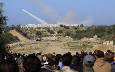 A rocket is fired into the sea during a military drill organized by terror groups outside Gaza City, Tuesday, Dec. 29, 2020. (AP Photo/Adel Hana)