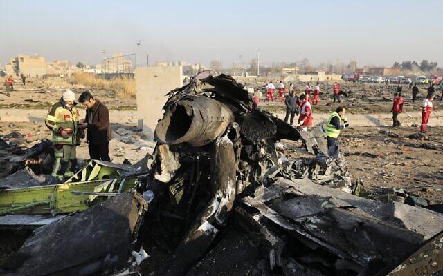 Debris litters the scene where a Ukrainian plane crashed in Shahedshahr southwest of the capital Tehran, Iran, January 8, 2020. (AP Photo/Ebrahim Noroozi, File)