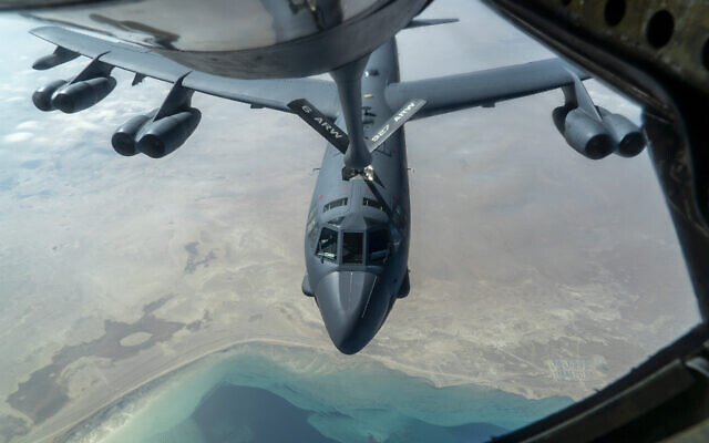 A US Air Force B-52H 'Stratofortress' from Minot Air Force Base, N.D., is refueled by a KC-135 'Stratotanker' in the US Central Command area of responsibility, Dec. 30, 2020. (Senior Airman Roslyn Ward/U.S. Air Force via AP)