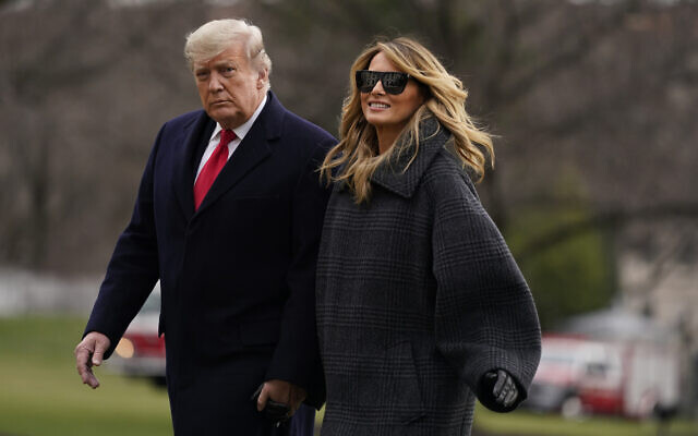 US President Donald Trump and first lady Melania Trump arrive on the South Lawn of the White House, December 31, 2020, in Washington. (AP Photo/Evan Vucci)
