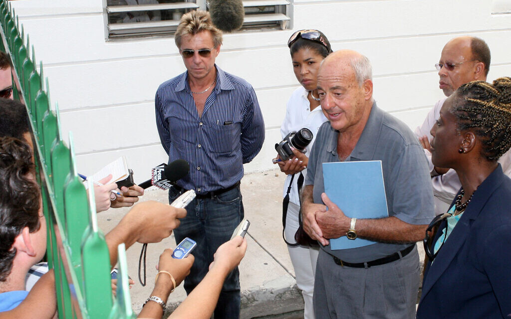 Pathologist Cyril Wecht, center, talks to the media while Bahamas' head coroner Linda Virgil, right, and attorney Michael Scott, left, listen, outside  the Rand Laboratory morgue at the Princess Margaret Hospital in Nassau, Bahamas, September 17, 2006. (AP Photo/Tim Aylen)