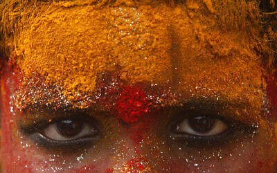 Illustrative: A young devotee, face smeared with turmeric powder, participates in a procession towards Golconda Fort during Bonalu festival in Hyderabad, India, July 15, 2010. (AP Photo/Mahesh Kumar A.)