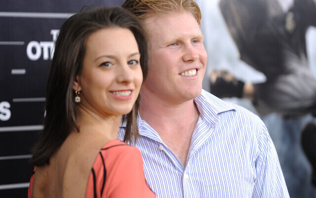 Andrew Giuliani (R) and Olympic figure skater Sarah Hughes attend the the world premiere of 'The Other Guys' at the Ziegfeld Theatre on Monday, Aug. 2, 2010 in New York. (AP Photo/Evan Agostini)