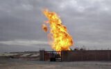 File: Flames are seen after an explosion at a gas terminal in Egypt's northern Sinai Peninsula on Saturday, Feb. 5, 2011 in El-Arish (AP Photo/Ashraf Swailem)