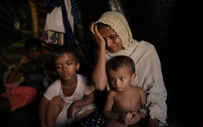 Jamila Begum, 35, cries when talking about how members of Myanmar's armed forces accused of massacring civilians in her village Maung Nu, in Myanmar's Rakhine State, killed her son and husband, in an interview with The Associated Press in Kutupalong refugee camp in Bangladesh, November 26, 2017. (AP Photo/Wong Maye-E)
