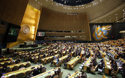 Illustrative: People gather at the General Assembly, prior to a vote, December 21, 2017, at United Nations headquarters. (AP Photo/Mark Lennihan)