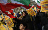 Illustrative -- Demonstrators of Iranian opposition group PMOI (People's Mujahedin Organization) protest near the Iran's embassy in Paris, Jan. 3, 2018, in solidarity with those demonstrating in Iran (AP Photo/Christophe Ena)