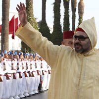 Moroccan King Mohammed VI waves to a crowd as he arrives for the opening session of the Moroccon Parliament in Rabat, Morocco, Oct. 12, 2018. (AP Photo/Abdeljalil Bounhar)