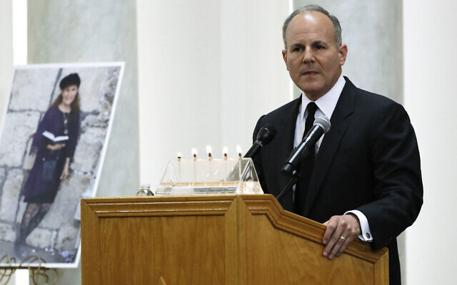 Elan Carr, the United States Special Envoy for Monitoring and Combating anti-Semitism, speaks Monday, April 29, 2019, next to a photo of Lori Kaye, who was killed when a gunman opened fire inside the Chabad of Poway synagogue, during a memorial service for Kaye in Poway, Calif. (AP Photo/Gregory Bull)