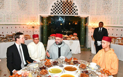 In this photo provided by the Moroccan News Agency (MAP), Moroccan King Mohammed VI, center, chats with Jared Kushner, Senior Adviser to President Donald Trump, left, as Crown Prince Moulay Hassan, right looks on before an Iftar meal, the evening meal when Muslims end their daily Ramadan fast at sunset, at the King Royal residence in Sale, Morocco, May 28, 2019. (Moroccan Royal Palace, via AP)
