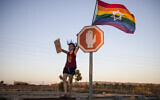Illustrative: An Israeli woman from the LGBT community demonstrates against gay conversion therapy, in southern Israel, July 14, 2019. (Tsafrir Abayov/AP)