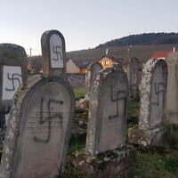 Tombs tagged with swastikas are pictured in a Jewish cemetery in Westhoffen, eastern France, Tuesday, Dec 3, 2019. (AP Photo)