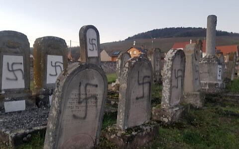 Tombs tagged with swastikas are pictured in a Jewish cemetery in Westhoffen, eastern France, December 3, 2019. (AP Photo)