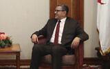 Turkey's Foreign Minister Mevlut Cavusoglu, left, and Algeria's Prime Minister Abdelaziz Djerad speak during a meeting in Algiers, Algeria, Jan. 7, 2020. (Turkish Foreign Ministry via AP, Pool)