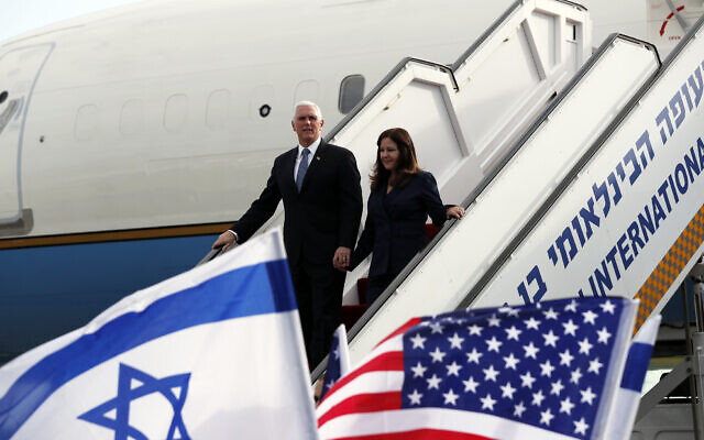 US Vice President Mike Pence and his wife Karen disembark from a plane upon their arrival at Ben Gurion International Airport to attend the World Holocaust Forum at the Yad Vashem memorial center, January 23, 2020. (Ammar Awad/Pool Photo via AP)
