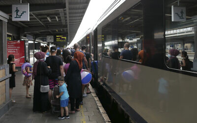 Illustrative: People wait to board a train in Brussels to the Belgian coastal resort of Blankenberge, Belgium on August 11, 2020. (AP Photo/Sylvain Plazy)