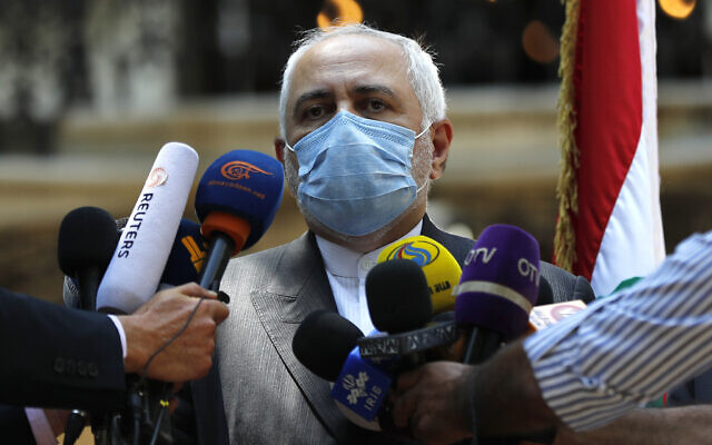 Iranian Foreign Minister Mohammad Javad Zarif speaks outside the Lebanese Foreign Ministry, August 14, 2020. (AP Photo/Hussein Malla)