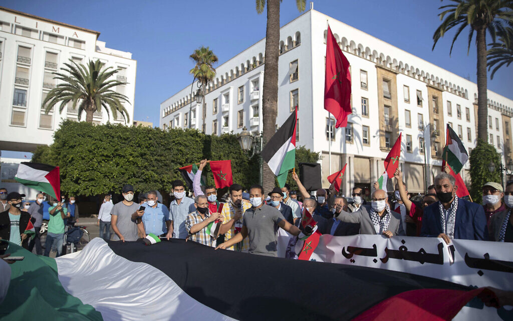 People hold a large Palestinian flag during a protest against normalizing relations with Israel, in Rabat, Morocco, Friday, September 18, 2020. (AP/Mosa'ab Elshamy)