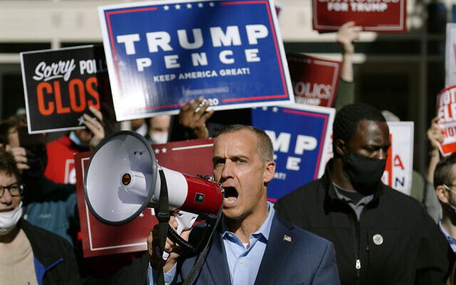 US President Donald Trump's campaign advisor Corey Lewandowski, center, speaks about a court order obtained to grant more access to vote counting operations at the Pennsylvania Convention Center, Thursday, Nov. 5, 2020, in Philadelphia, following Tuesday's election. (AP Photo/Matt Slocum)