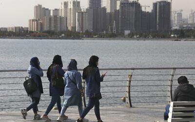 People spend their weekend on the shore of Persian Gulf Martyrs' Lake, in western Tehran, Iran, November 5, 2020. (Vahid Salemi/AP)